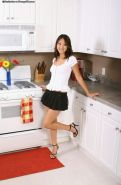 Evelyn Lin Asian teen strips and poses on kitchen