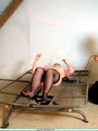 Pussy whipping and extreme spanking of tied painslave Nimue on a metalframe