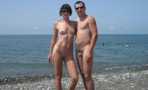 Watch these smooth nudists play at a public beach