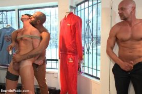 Sexy stud endures electricity, cocks and feet in a clothing store.