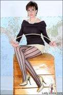 Mature long legs dominatrix in patterned pantyhose