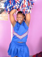 Ebony teen cheerleader loves to tease while playing dildo