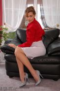 Redhead lady Claire in silk stockings
