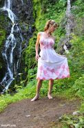 Pretty Delia by waterfall erect under her dress
