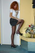 Redhead Lady Claire posing in her finest pantyhose
