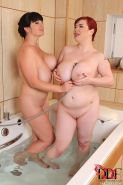 Two BBWs in the shower going dyke