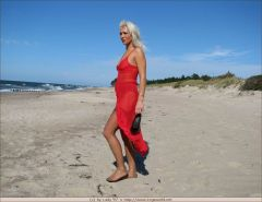Blonde milf in brown stockings strips on the beach