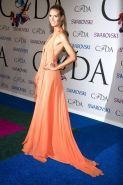 Heidi Klum braless showing cleavage and sideboob at the 2014 CFDA Fashion Awards