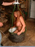 Busty fetish slavegirl Gina in bondage and hotwax punishment in the barn