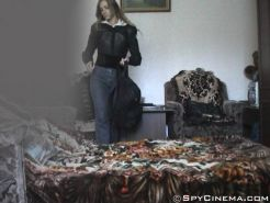 Undressing girl caught on bedroom spy cam