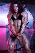 Massive Female Bodybuilder posing in contest shape