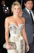 Shakira busty wearing a strapless little dress at NRJ Music Awards in Cannes
