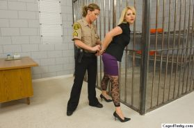 Blonde gets undressed in the jail
