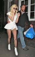Lady Gaga in ripped fishnet stockings flashing her panties in public