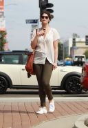 Gemma Arterton cleavy wearing see-thru to bra top and skintight pants out in Hol