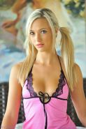 Pigtail blonde in babydoll lingerie and stockings
