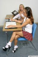 Schoolgirl lesbians playing with anal dildo