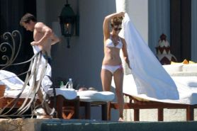 Kate Beckinsale in bikini on beach and posing