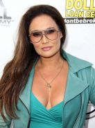 Tia Carrere shows huge cleavage wearing a low cut dress at the 'Gutshot Straight