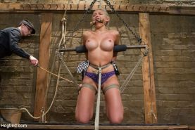 Kaite Summers suspended in rope bondage and punishment