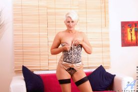 Seductive hot milf Sally Taylor satisfies her pussy with a silver dildo on the c