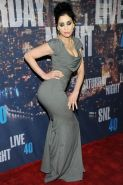 Sarah Silverman busty showing big cleavage in a tight gray dress while attending