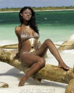 Nice exotic beautiful ebony Jenna Brooks lies on the beach