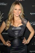 Jewel Kilcher showing big cleavage in a tight leather dress at 11th Annual Tree