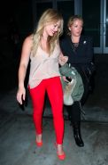 Hilary Duff wearing tank top and red tights leaving Pink concert at the Staples