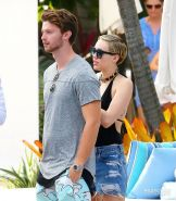 Miley Cyrus wearing swimsuit and hotpants at a pool in Miami