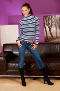 Angel Dark posing in black stockings and boots