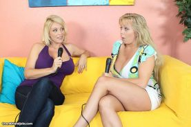 Busty milf Amber Lynn Bach gives handjob to a cameran live on tv