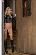Nicole Graves opens up her leather jacket and strips off her sexy lingerie