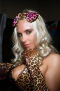 Busty babe Nicole Coco Austin showing off her hot curves in a skimpy leopard cos