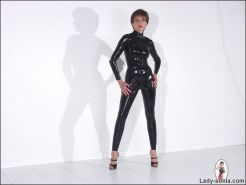 Skintight black rubber catsuit leggy milf mistress lady sonia