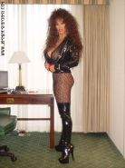 Smoking redhead Jasmine in high latex boots and sexy pantyhose