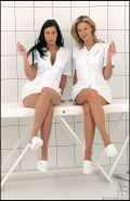 Beautiful lesbian nurses licking their yummy feet in stockings
