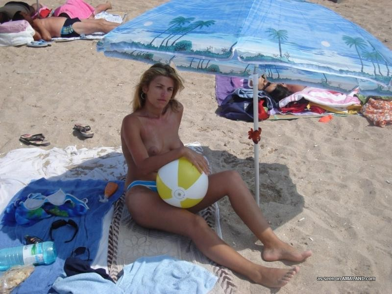 Amateur blonde wife going topless at the beach #67971383