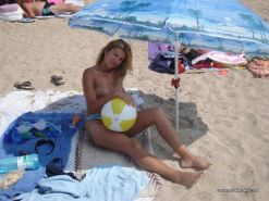 Amateur blonde wife going topless at the beach #67971398