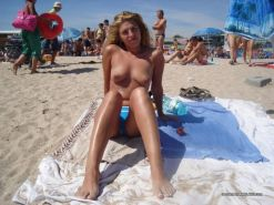 Amateur blonde wife going topless at the beach #67971418