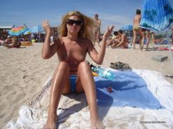 Amateur blonde wife going topless at the beach #67971424