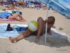 Amateur blonde wife going topless at the beach #67971428