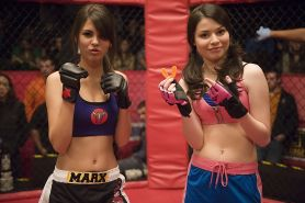 Miranda Cosgrove wearing sports bra and shorts boxing with Victoria Justice on t