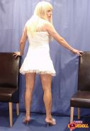 Blonde tranny in a frilly dress
