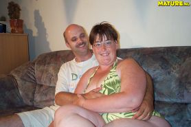 Mature couple having sex on their scruffy couch