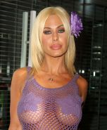 Shauna Sand revealing her nice big tits under see thru fishnet top and on beach