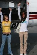 Brooke and Sam jump out of a plane