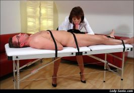 Nurse giving head to strapped down guy