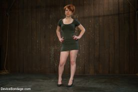 Juliette March redhead is bound to the wall and machine fucked
