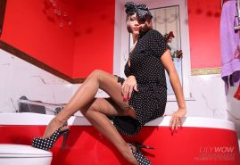 Stocking babe Lily Wow showes her long legs in the bathroom